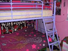PURPLE METAL FRAMED BUNK BEDS